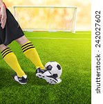 a soccer ball in front of goal  | Shutterstock . vector #242027602