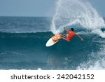 A Surfer Throws A Huge Plume Of ...
