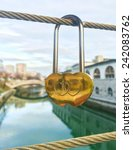 gold heart shaped padlock... | Shutterstock . vector #242083762