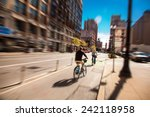 people on bikes in chicago... | Shutterstock . vector #242118958