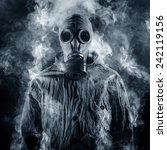 A Man In A Gas Mask Shrouded I...