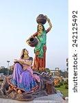 Small photo of FEBRUARY 27, 2014, VRINDAVAN, UTTAR-PRADESH, INDIA - Sculpture of talking gopis Lalita and Vishakha close to Prem Mandir or Temple of Love