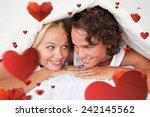 couple under a duvet with a... | Shutterstock . vector #242145562