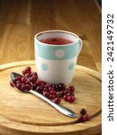 cranberry tea and berry on the... | Shutterstock . vector #242149732