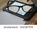 black ereader with retro... | Shutterstock . vector #242187595