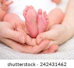 mother holding her newborn baby'... | Shutterstock . vector #242431462
