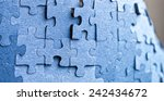 Real photograph of the backside of blue puzzle jigsaw in available light. - stock photo