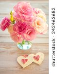 Love Vintage Background - Beautiful Flowers and Two Handmade Hearts, light colored - stock photo
