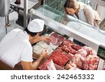 high angle view of male butcher ... | Shutterstock . vector #242465332