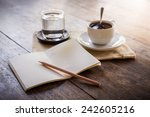 cup of coffee on a wooden table ... | Shutterstock . vector #242605216