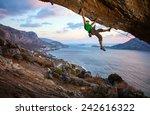 male climber climbing... | Shutterstock . vector #242616322