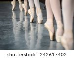 Legs dancers on pointe  near...