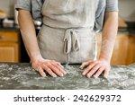 young baker preparing artisan...   Shutterstock . vector #242629372