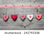 red hearts hanging over rustic... | Shutterstock . vector #242792338