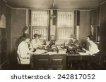 Small photo of National Women's Party Press Room at their Washington. D.C. headquarters. Lead by Alice Paul, the NWP conducted increasingly militant protests demanding votes for women. Ca. 1915.