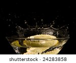 Lemon slice falling into cocktail - stock photo
