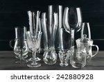 different glassware on dark...   Shutterstock . vector #242880928