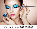 makeup artist applies eye... | Shutterstock . vector #242959762