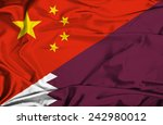 waving flag of qatar and china | Shutterstock . vector #242980012