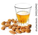 Small photo of Dessert liqueur Amaretto with almond nuts, isolated on white
