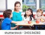 Happy Female Teacher In A Mult...