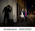 hooded man stalking two women... | Shutterstock . vector #243213322