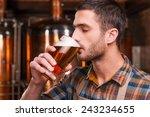tasting fresh brewed beer.... | Shutterstock . vector #243234655