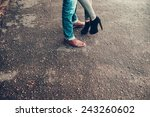 legs of a young couple in love   Shutterstock . vector #243260602