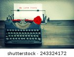 Small photo of Vintage typewriter with white paper and red rose flower. Sample text My Love Story. Vintage style toned grungy picture