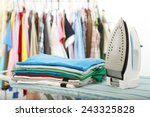 electric iron and shirt  on... | Shutterstock . vector #243325828