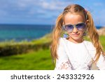 adorable little girl outdoors... | Shutterstock . vector #243332926