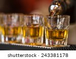 barman makes whisky shot drinks ... | Shutterstock . vector #243381178
