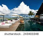 luxury poolside jetty at... | Shutterstock . vector #243403348
