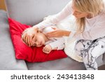 mother with her sick kid at home | Shutterstock . vector #243413848