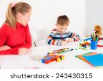 mother looking at her drawing... | Shutterstock . vector #243430315