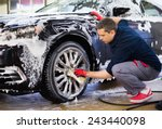 man worker washing car's alloy... | Shutterstock . vector #243440098
