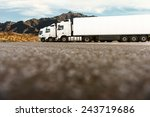 three white trucks on a parking ... | Shutterstock . vector #243719686
