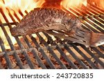beef steak and spatula on hot... | Shutterstock . vector #243720835