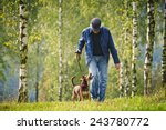 Stock photo dog man forest 243780772