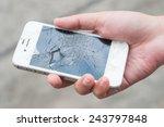 hands holding broken mobile... | Shutterstock . vector #243797848