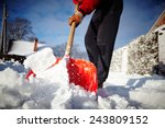 man with snow shovel cleans... | Shutterstock . vector #243809152