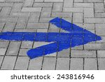 Blue Arrow On Grey Paving ...