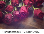 Stock photo vintage filter red roses gift for valentines day birthday or special occasion on recycled 243842902