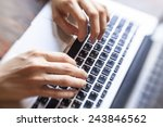female hands typing text on the ... | Shutterstock . vector #243846562