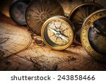 Old Compass On Vintage Map....