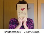 Girl Holding Book With Cover I...