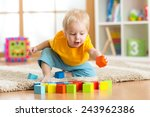 child toddler playing wooden... | Shutterstock . vector #243962386