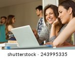 smiling friends sitting using... | Shutterstock . vector #243995335