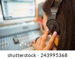 University student mixing audio ...