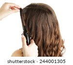 stylist using curling iron for... | Shutterstock . vector #244001305